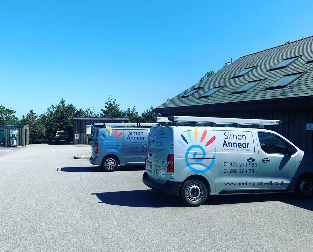 Simona Annear Plumbing, Heating & Electrics vans outside our head office in Truro, Cornwall